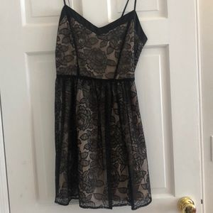 Black and taupe cocktail dress, lace overlay